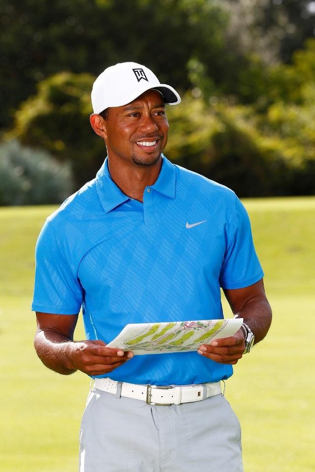 Tiger Woods looking left blue shirt